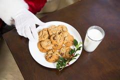 Santa has Cookies and milk Stock Image
