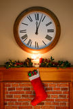 Santa has left some gifts. It's just past midnight on Christmas Eve / Day and Santa has been, gifts are in the stocking hanging over the fireplace, as candles Royalty Free Stock Image