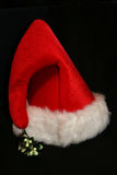 Santa Hat. A bright red Santa hat shot on black Stock Photos