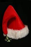 Santa Hat. A bright red Santa hat shot on black stock photos