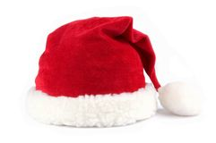 Santa Hat. Red santa claus hats over white background Royalty Free Stock Photos
