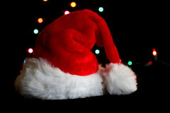 Santa Hat. On black background with holiday lights Stock Image