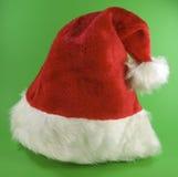 Santa hat. Isolated on green background Stock Image
