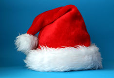 Santa hat. Red and white santa hat shot on a blue background Stock Image