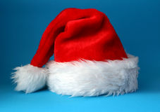 Santa hat. Red and white santa hat shot on a blue background Stock Photo