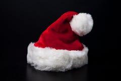 Santa Hat. A Santa Clause hat on black background Stock Image