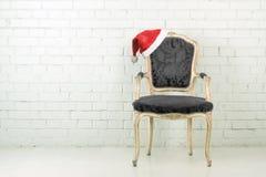 Santa hat on armchair Stock Image