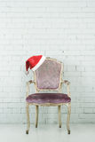 Santa hat on armchair Royalty Free Stock Image