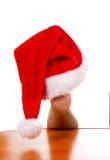 Santa Hat auf dem Bein Lizenzfreies Stockbild