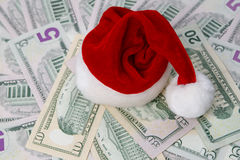 Santa hat on a background of money Royalty Free Stock Photography