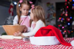 Santa Hat background of two little girl baking Stock Photography
