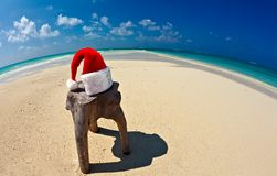 Santa hat is on a beach Royalty Free Stock Photo