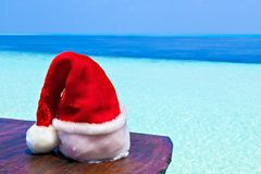 Santa hat is on a beach Stock Photography