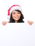 Santa Hat Behind White Board adolescente femenina joven Foto de archivo