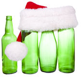 Santa hat and a bottle. In the background Stock Images