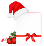 Santa hat with a card. Royalty Free Stock Photography