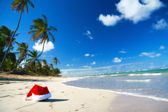 Santa hat on caribbean beach Royalty Free Stock Images