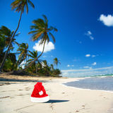 Santa hat on caribbean beach Stock Image