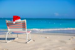Santa hat on chair longue at tropical white beach Stock Image