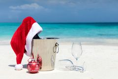 Santa hat on champagne bucket on a tropical beach. For the holiday season Stock Image