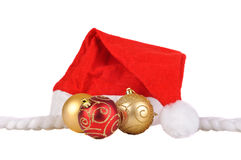 Santa hat with christmas balls Royalty Free Stock Photos