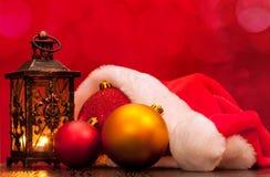 Santa hat and Christmas balls Royalty Free Stock Image
