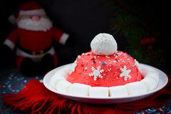 Santa hat Christmas cake. Winter hat cake with traditional ornament decoration. New Year dessert, Christmas treat for kids, Chris. Tmas food concept royalty free stock images