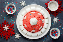 Santa hat Christmas cake. Winter hat cake with traditional ornam Royalty Free Stock Photo