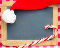 Santa hat and Christmas candy Stock Image