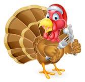 Santa Hat Christmas Cartoon Turkey que sostiene el cuchillo y la bifurcación Foto de archivo libre de regalías