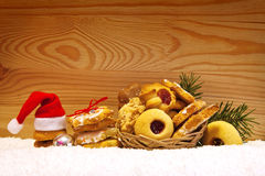 Santa hat and Christmas cookies. Stock Photo
