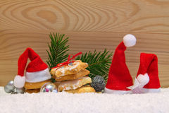 3 Santa hat and Christmas cookies. Stock Photo