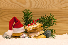 Santa hat and Christmas cookies. Stock Photos