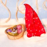 Santa Hat with Christmas decorations on snow Royalty Free Stock Photos