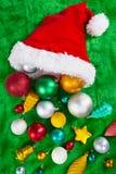 Santa hat and Christmas ornaments Stock Photo