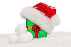 Santa hat on Christmas present covered in snow. Stock Photography