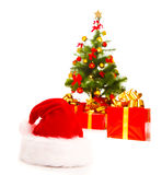 Santa hat and Christmas presents Royalty Free Stock Images