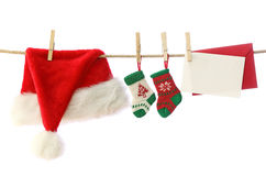 Santa hat and christmas socks Royalty Free Stock Images