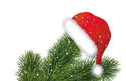 Santa hat on Christmas tree branches Stock Photography
