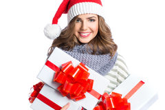 Santa hat Christmas woman holding christmas gifts. Royalty Free Stock Images