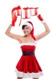 Santa hat Christmas woman holding christmas gifts smiling happy Stock Image