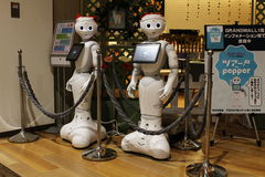 Santa-hat clad Pepper robots ready to communicate with customers in a Japanese shopping Mall Stock Image
