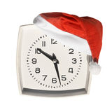 Santa hat on clock Royalty Free Stock Photography