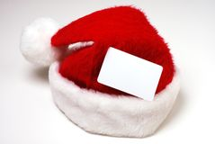 Santa Hat with Credit Card. Santa Claus hat with a blank credit card shaped space Stock Photo