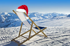 Santa hat on a deckchair on the side of a ski slope, snowy mountain Stock Images