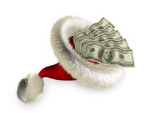 Santa_hat_with_dollars Lizenzfreie Stockfotografie