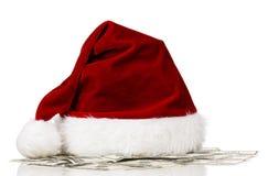Santa hat on dollars. Isolated on white background Royalty Free Stock Photos