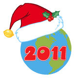 Santa Hat on a earth. 2011 New year earth wearing A santa hat vector illustration