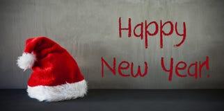 Santa Hat, Feliz Año Nuevo del texto Fotos de archivo libres de regalías