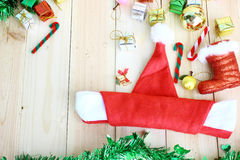 Santa Hat Folded Into A Boat And Christmas Decoration On Wood Background With Space For Text Stock Photos